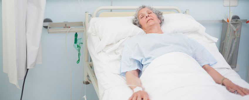 Elderly patient in hospital bed